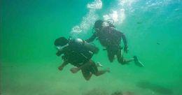 Gape beneath sea as you scuba dive in Kovalam