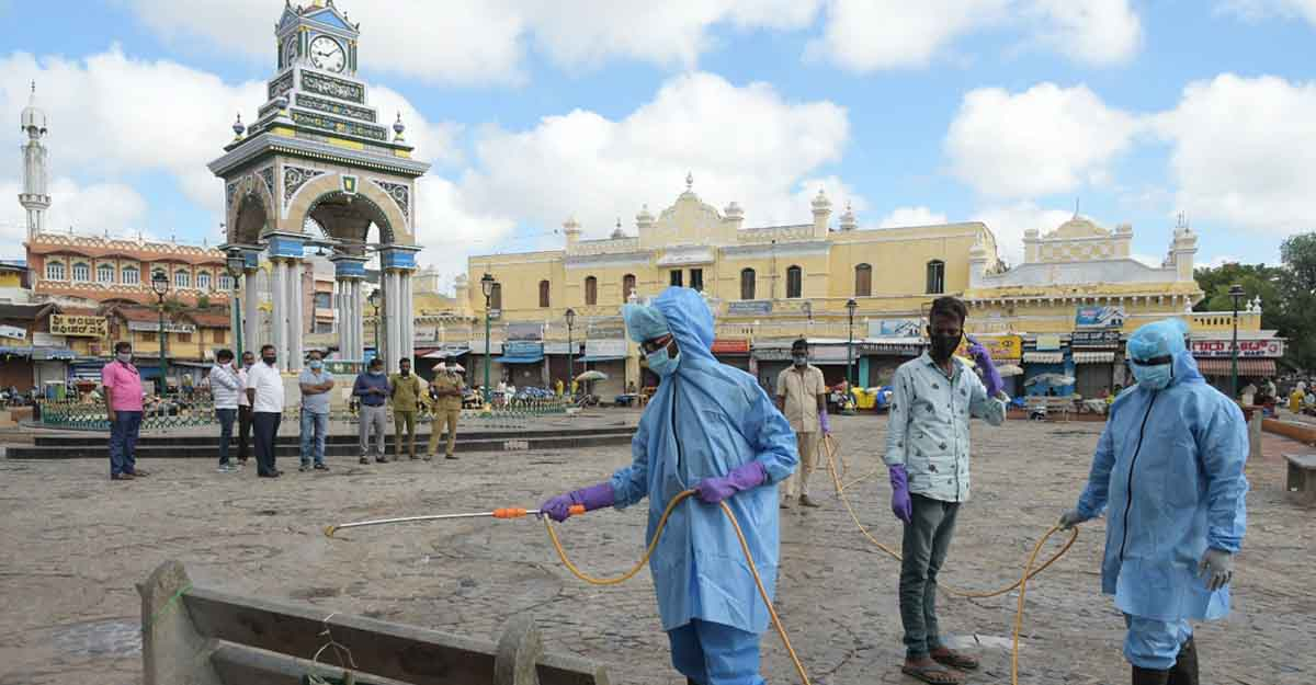 Mysuru: Fire personnel engaged in conducting sanitisation drive across public places in Mysuru amid rising cases of COVID-19, on June 25, 2020. (Photo: IANS)