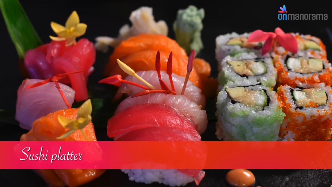 Japanese sushi platter with California maki, Nigiri and Sashimi