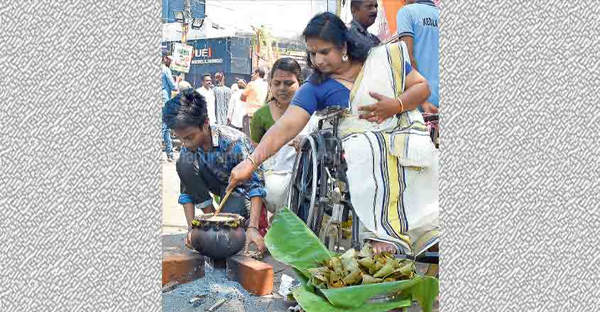 Sindhu offers Pongala from her wheelchair